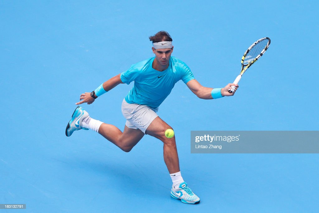 <a gi-track='captionPersonalityLinkClicked' href=/galleries/search?phrase=Rafael+Nadal&family=editorial&specificpeople=194996 ng-click='$event.stopPropagation()'>Rafael Nadal</a> of Spain returns a shot during his men's semi-final match against Tomas Berdych of Czech Republic on day eight of the 2013 China Open at the National Tennis Center on October 5, 2013 in Beijing, China.