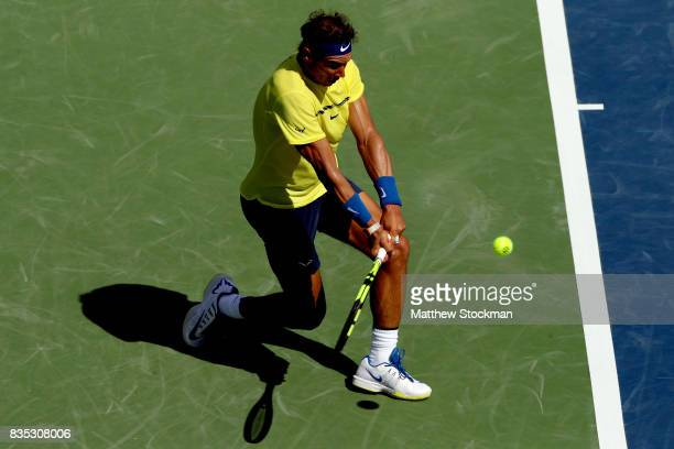 Rafael Nadal of Spain returns a shot to Albert RamosVinolas of Spain during day 7 of the Western Southern Open at the Lindner Family Tennis Center on...