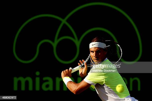 Rafael Nadal of Spain returns a shot to Fernando Verdasco of Spain during day 7 of the Miami Open Presented by Itau at Crandon Park Tennis Center on...