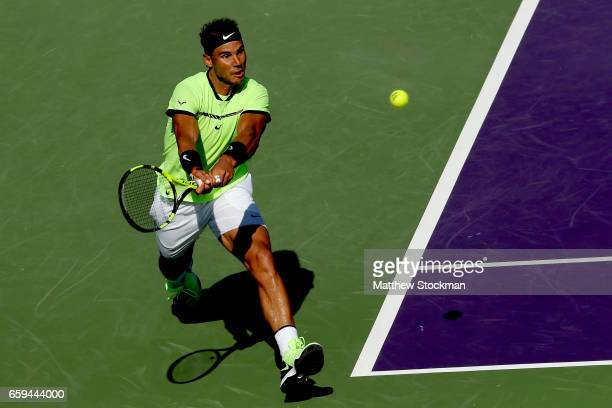 Rafael Nadal of Spain returns a shot to Nicolas Mahut of France during the Miami Open at the Crandon Park Tennis Center on March 28 2017 in Key...