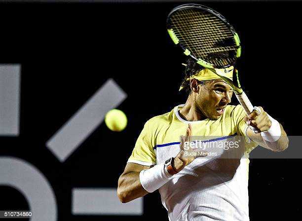 Rafael Nadal of Spain returns a shot to Pablo Carreno Busta of Spain during the Rio Open at Jockey Club Brasileiro on February 16 2016 in Rio de...