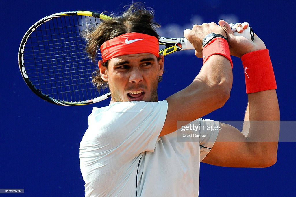 <a gi-track='captionPersonalityLinkClicked' href=/galleries/search?phrase=Rafael+Nadal&family=editorial&specificpeople=194996 ng-click='$event.stopPropagation()'>Rafael Nadal</a> of Spain returns the ball against Benoit Paire of France during day five of the 2013 Barcelona Open Banc Sabadell on April 26, 2013 in Barcelona, Spain. <a gi-track='captionPersonalityLinkClicked' href=/galleries/search?phrase=Rafael+Nadal&family=editorial&specificpeople=194996 ng-click='$event.stopPropagation()'>Rafael Nadal</a> won 7-6, 6-2..