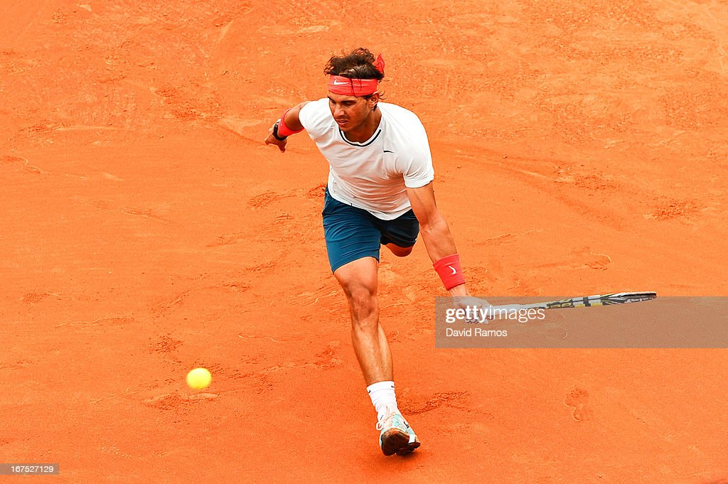Rafael Nadal of Spain returns the ball against Benoit Paire of France during day five of the 2013 Barcelona Open Banc Sabadell on April 26, 2013 in Barcelona, Spain. Rafael Nadal won 7-6, 6-2..