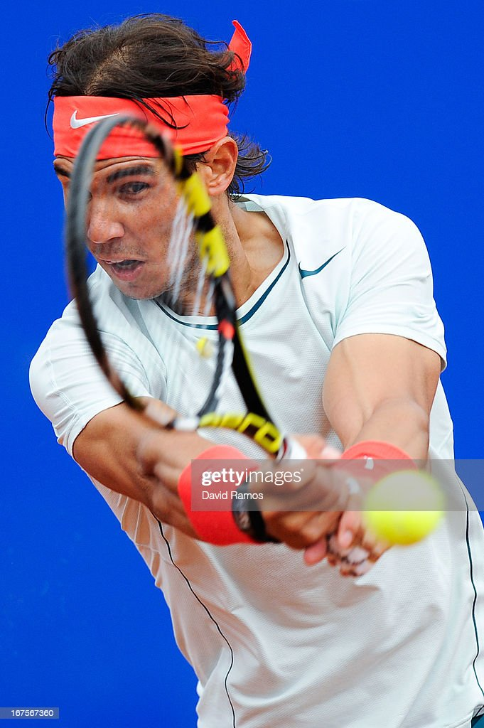 <a gi-track='captionPersonalityLinkClicked' href=/galleries/search?phrase=Rafael+Nadal&family=editorial&specificpeople=194996 ng-click='$event.stopPropagation()'>Rafael Nadal</a> of Spain returns the ball to Albert Ramos of Spain during their quarter-final match during day five of the 2013 Barcelona Open Banc Sabadell on April 26, 2013 in Barcelona, Spain. <a gi-track='captionPersonalityLinkClicked' href=/galleries/search?phrase=Rafael+Nadal&family=editorial&specificpeople=194996 ng-click='$event.stopPropagation()'>Rafael Nadal</a> won 6-3, 6-0.
