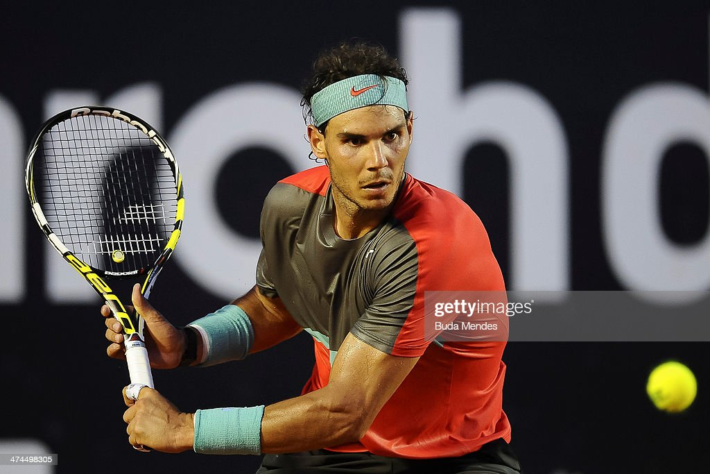 <a gi-track='captionPersonalityLinkClicked' href=/galleries/search?phrase=Rafael+Nadal&family=editorial&specificpeople=194996 ng-click='$event.stopPropagation()'>Rafael Nadal</a> of Spain returns the ball to Alexandr Dolgopolov of Ukraine during the ATP Rio Open 2014 at Jockey Club Rio de Janeiro on February 23, 2014 in Rio de Janeiro, Brazil.