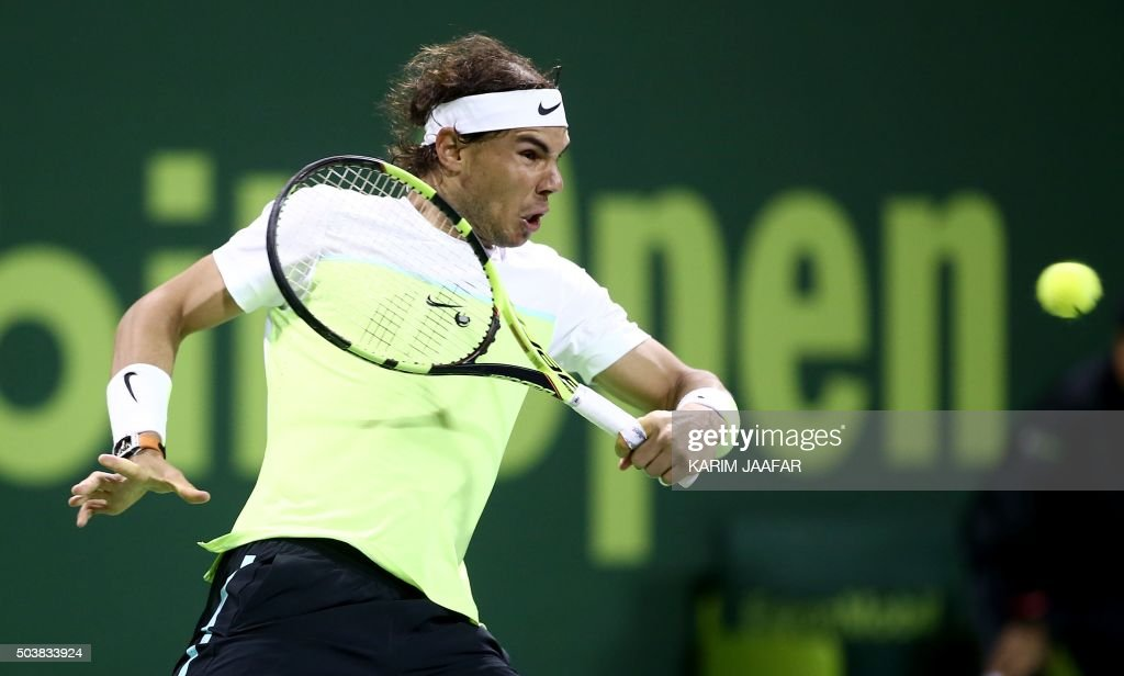 TOPSHOT Rafael Nadal of Spain returns the ball to Andrey Kuznetsov of Russia during their tennis match in the Qatar Open tournament on January 7 in...