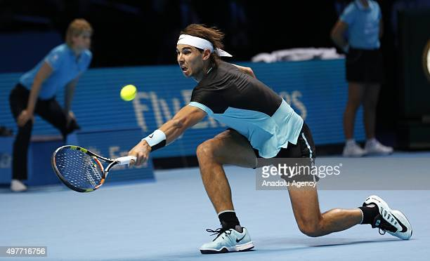 Rafael Nadal of Spain returns the ball to Andy Murray of Great Britain during the men's singles match at the ATP World Tour Finals tennis tournament...