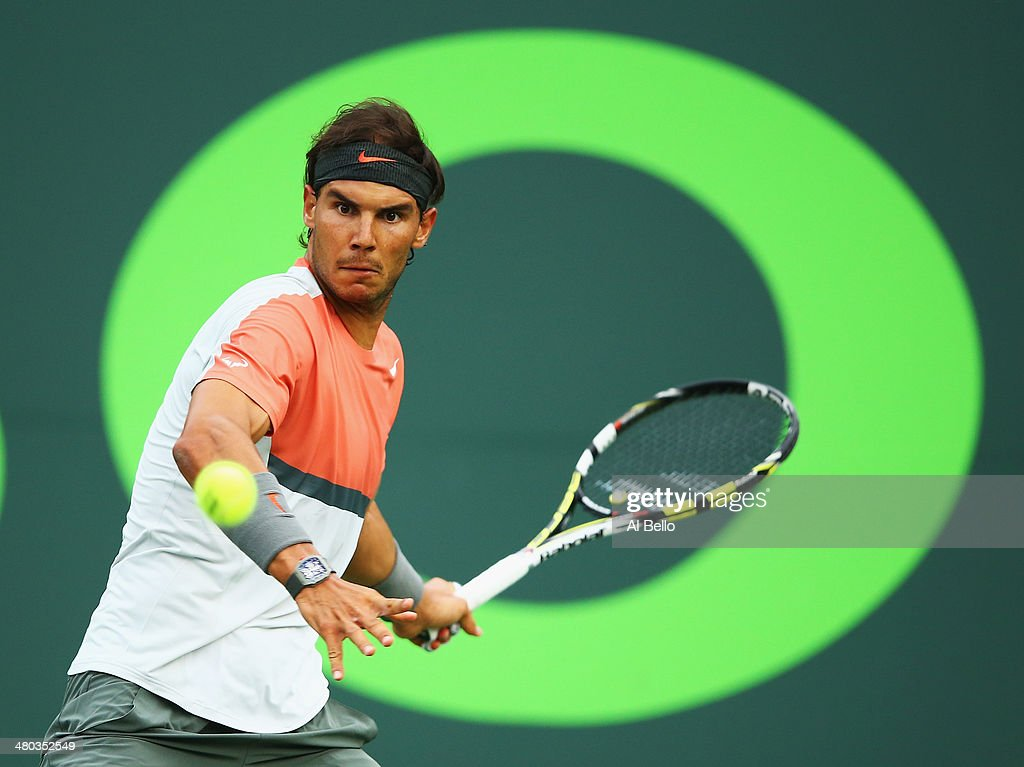 Rafael Nadal of Spain returns the ball to Denis Istomin of Uzbekistan during their match on day 8 of the Sony Open at Crandon Park Tennis Center on March 24, 2014 in Key Biscayne, Florida.