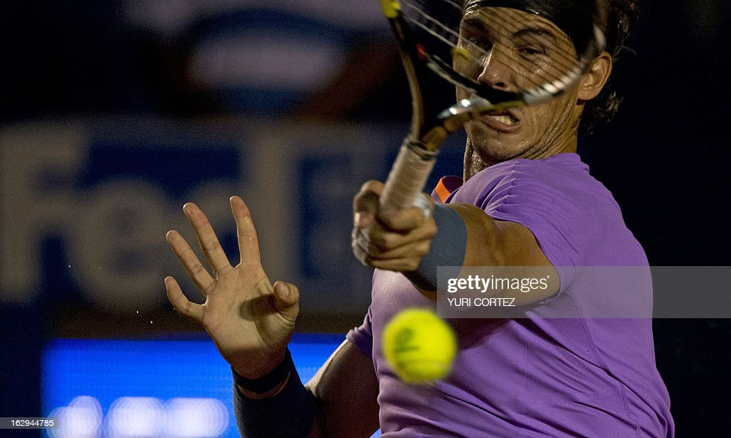 Rafael Nadal of Spain returns the ball to his compatriot Nicolas Almagro during their semi-final Mexico ATP Open men's single tennis match, in Acapulco, Guerrero state on March 1, 2013. AFP PHOTO/ Yuri CORTEZ
