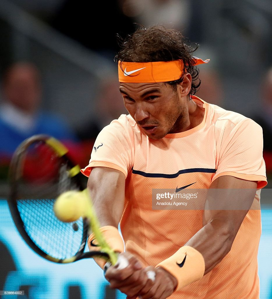 Rafael Nadal of Spain returns the ball to Joao Sousa of Portugal in their quarter final round match during at the Mutua Madrid Open tennis tournament at the Caja Magica in Madrid, Spain on May 06, 2016.