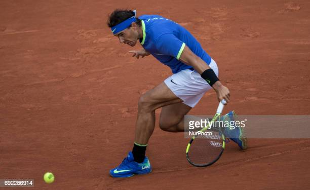 Rafael Nadal of Spain returns the ball to Roberto Bautista Agut of Spain during the fourth round at Roland Garros Grand Slam Tournament Day 8 on June...