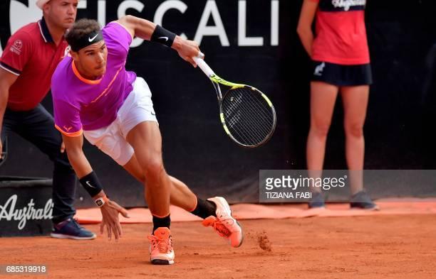Rafael Nadal of Spain runs to catch a ball as he plays against Dominic Thiem of Austria during their quarterfinal tennis match at the ATP Tennis Open...