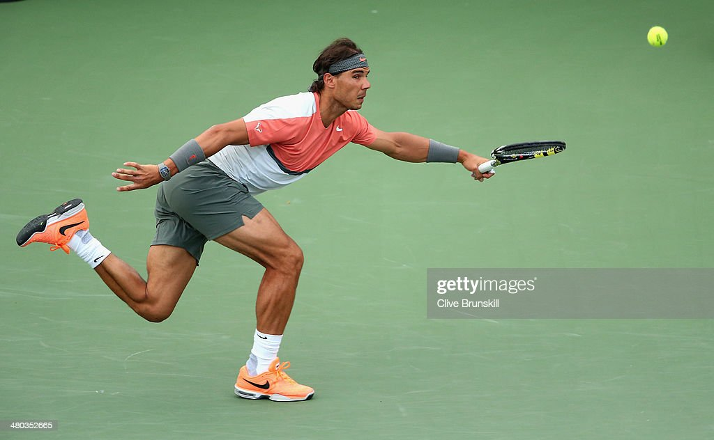 Rafael Nadal of Spain runs to play a forehand against Denis Istomin of Uzebekistan during their third round match during day 8 at the Sony Open at Crandon Park Tennis Center on March 24, 2014 in Key Biscayne, Florida.