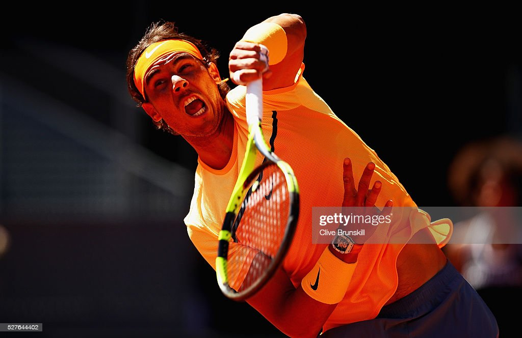 Rafael Nadal of Spain serves against Andrey Kuznetsov of Russia in their second round match during day four of the Mutua Madrid Open tennis tournament at the Caja Magica on May 03, 2016 in Madrid,Spain.