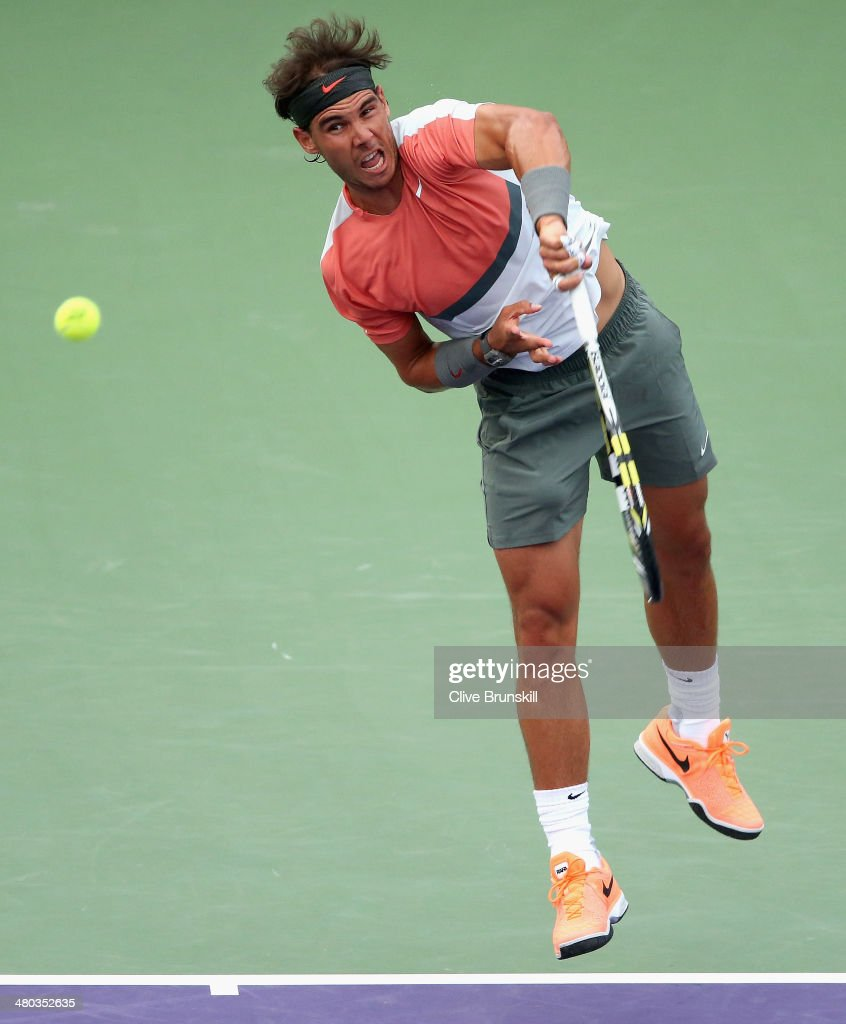 Rafael Nadal of Spain serves against Denis Istomin of Uzebekistan during their third round match during day 8 at the Sony Open at Crandon Park Tennis Center on March 24, 2014 in Key Biscayne, Florida.