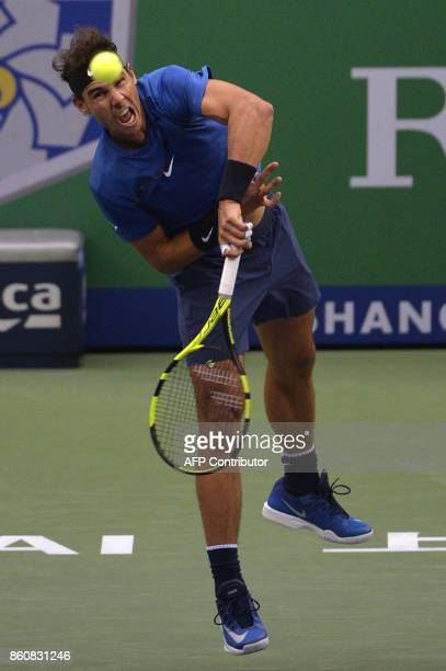 Rafael Nadal of Spain serves against Grigor Dimitrov of Bulgaria during their men's singles quarterfinal match at the Shanghai Masters tennis...