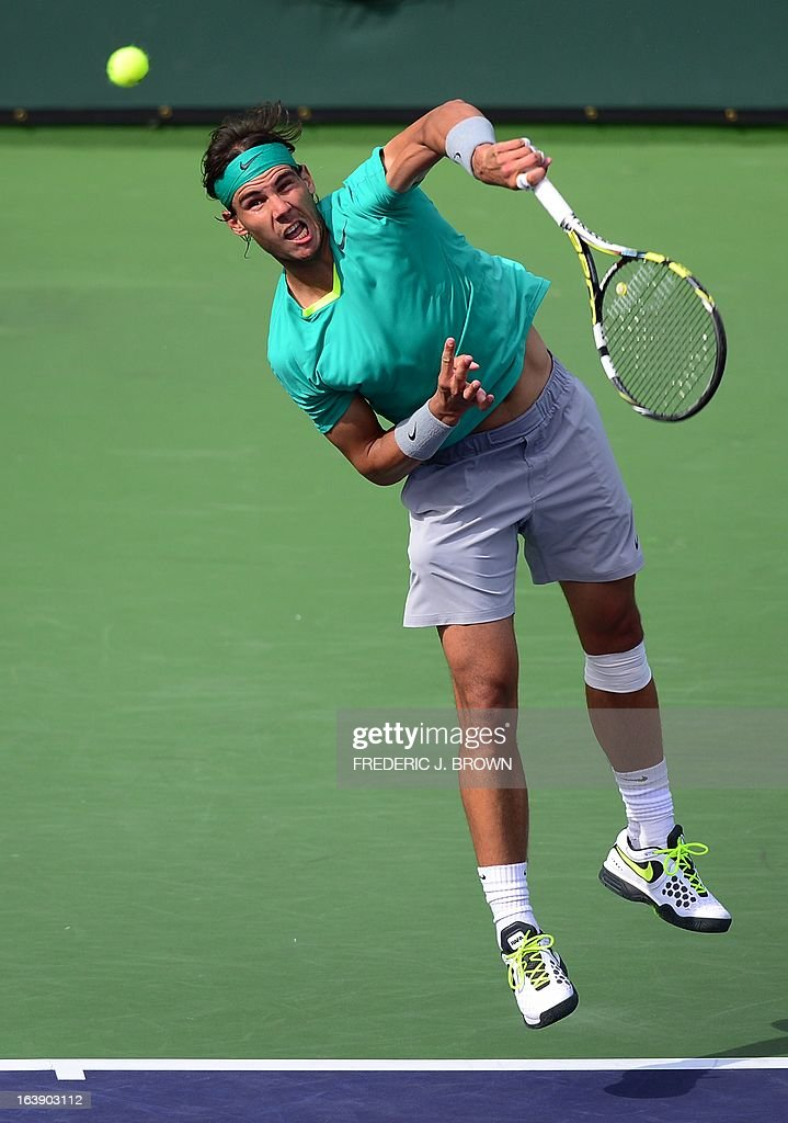 Rafael Nadal of Spain serves against Juan Martin Del Potro of Argentina on March 17, 2013 in Indian Wells, California, in the men's tennis final at the BNP Paribas Open. AFP PHOTO/Frederic J. BROWN