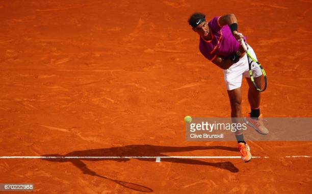 Rafael Nadal of Spain serves against Kyle Edmund of Great Britain in his second round match on day four of the Monte Carlo Rolex Masters at...