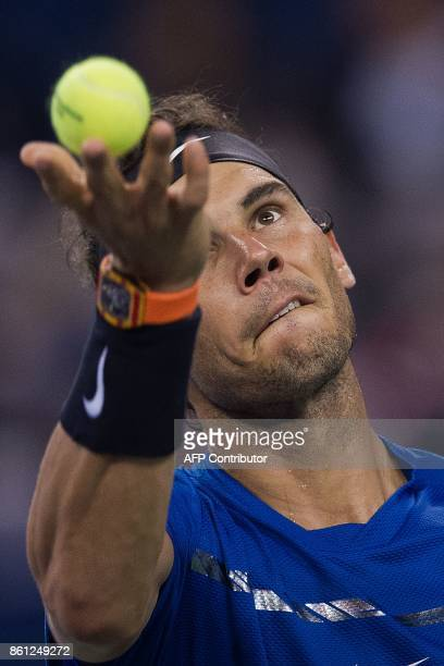 Rafael Nadal of Spain serves during his men's semifinals singles match against Marin Cilic of Croatia at the Shanghai Masters tennis tournament in...