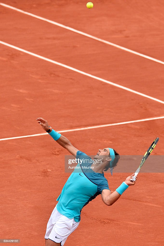 <a gi-track='captionPersonalityLinkClicked' href=/galleries/search?phrase=Rafael+Nadal&family=editorial&specificpeople=194996 ng-click='$event.stopPropagation()'>Rafael Nadal</a> of Spain serves during his men's single second round match against Facundo Bagnis of Argentina on day five of the 2016 French Open at Roland Garros on May 26, 2016 in Paris, France.