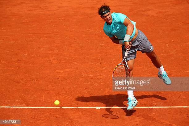 Rafael Nadal of Spain serves during his men's singles match against dominic thiem of Austria on day five of the French Open at Roland Garros on May...