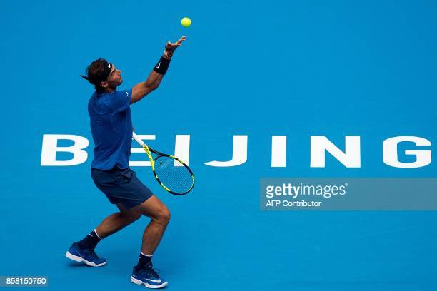 TOPSHOT Rafael Nadal of Spain serves during his men's singles quarterfinal match against John Isner of the US at the China Open tennis tournament in...