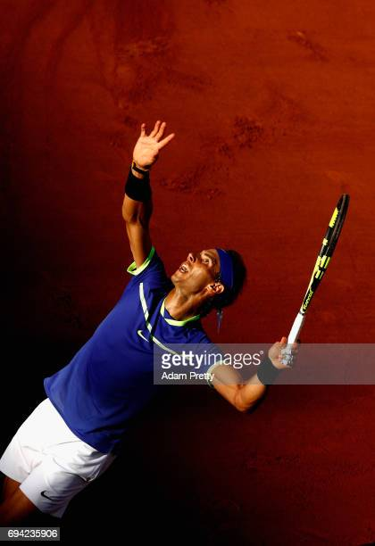Rafael Nadal of Spain serves during mens singles semifinal match against Dominic Thiem of Austria on day thirteen of the 2017 French Open at Roland...