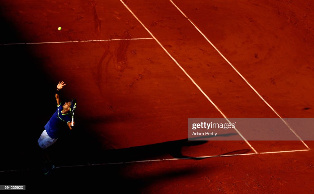 Rafael Nadal of Spain serves during mens singles semi-final match against Dominic Thiem of Austria on day thirteen of the 2017 French Open at Roland Garros on June 9, 2017 in Paris, France.