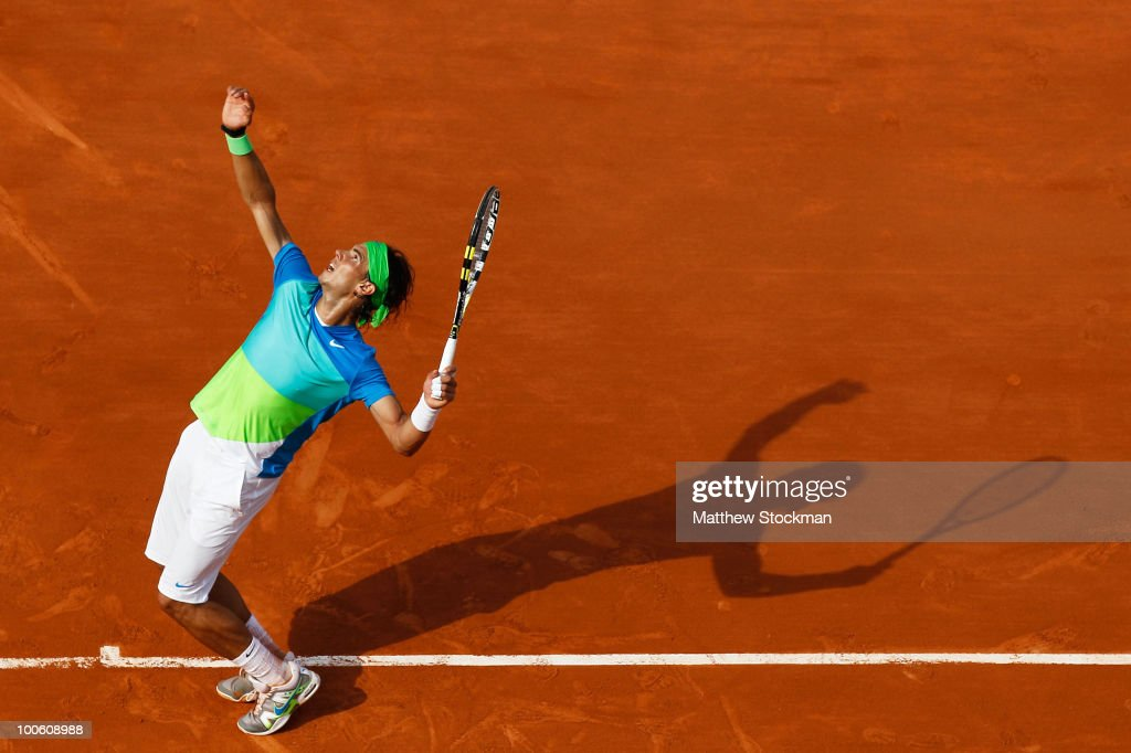 Rafael Nadal of Spain serves during the men's singles first round match between Rafael Nadal of Spain and Gianni Mina of France on day three of the French Open at Roland Garros on May 25, 2010 in Paris, France.
