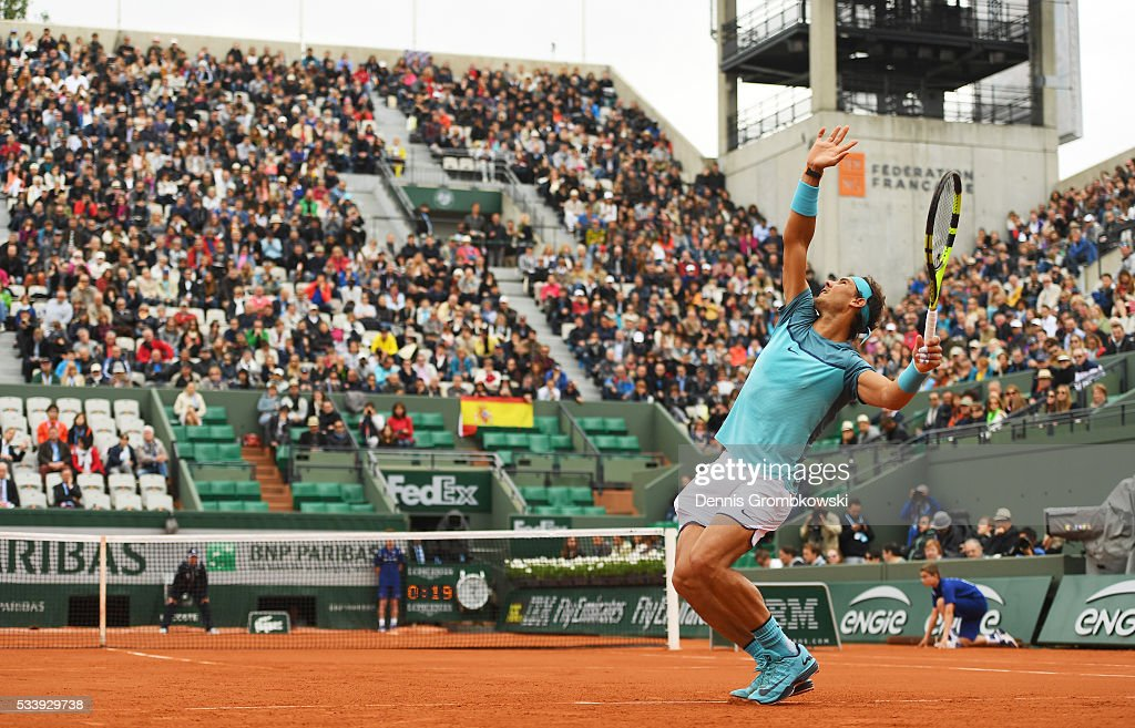 <a gi-track='captionPersonalityLinkClicked' href=/galleries/search?phrase=Rafael+Nadal&family=editorial&specificpeople=194996 ng-click='$event.stopPropagation()'>Rafael Nadal</a> of Spain serves during the Men's Singles first round match against Sam Groth of Australia on day three of the 2016 French Open at Roland Garros on May 24, 2016 in Paris, France.
