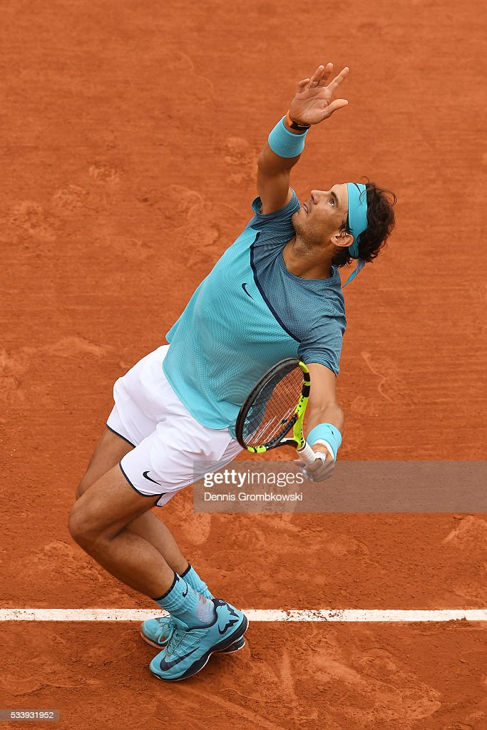 Rafael Nadal of Spain serves during the Men's Singles first round match against Sam Groth of Australia on day three of the 2016 French Open at Roland Garros on May 24, 2016 in Paris, France.