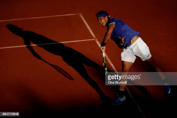 Rafael Nadal of Spain serves during the men's singles semi final match against Dominic Thiem of Austria on day thirteen of the 2017 French Open at...