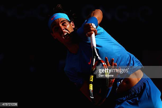 Rafael Nadal of Spain serves in his Men's quarter final match against Novak Djokovic of Serbia on day eleven of the 2015 French Open at Roland Garros...