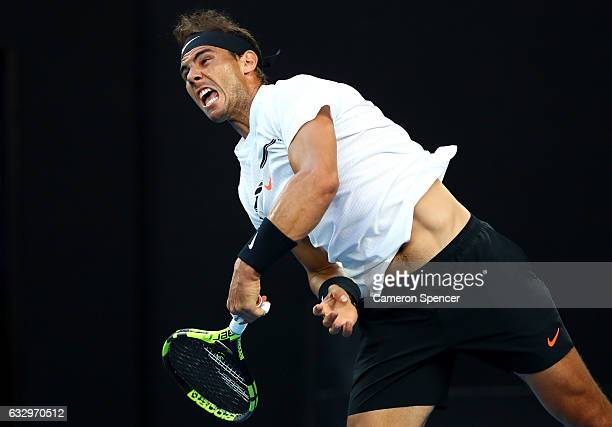 Rafael Nadal of Spain serves in his Men's Singles Final match against Roger Federer of Switzerland on day 14 of the 2017 Australian Open at Melbourne...