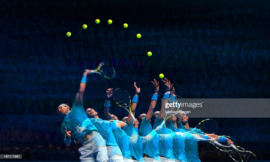 <a gi-track='captionPersonalityLinkClicked' href=/galleries/search?phrase=Rafael+Nadal&family=editorial&specificpeople=194996 ng-click='$event.stopPropagation()'>Rafael Nadal</a> of Spain serves in his men's singles match against Stanislas Wawrinka of Switzerland during day three of the Barclays ATP World Tour Finals at O2 Arena on November 6, 2013 in London, England.
