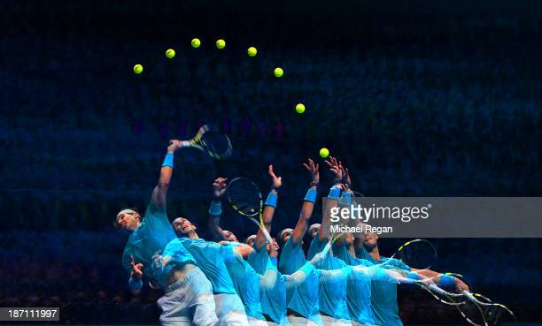 Rafael Nadal of Spain serves in his men's singles match against Stanislas Wawrinka of Switzerland during day three of the Barclays ATP World Tour...