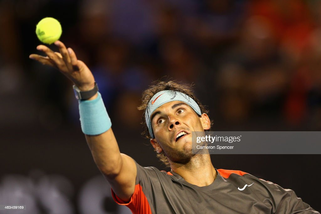 <a gi-track='captionPersonalityLinkClicked' href=/galleries/search?phrase=Rafael+Nadal&family=editorial&specificpeople=194996 ng-click='$event.stopPropagation()'>Rafael Nadal</a> of Spain serves in his third round match against Gael Monfils of France during day six of the 2014 Australian Open at Melbourne Park on January 18, 2014 in Melbourne, Australia.