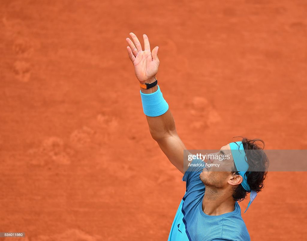 Rafael Nadal (C) of Spain serves the ball during the men's single first round match against Sam Groth of Australia at the French Open tennis tournament at Roland Garros in Paris, France on May 24, 2016.
