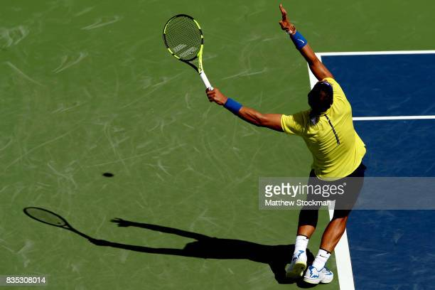 Rafael Nadal of Spain serves to Albert RamosVinolas of Spain during day 7 of the Western Southern Open at the Lindner Family Tennis Center on August...