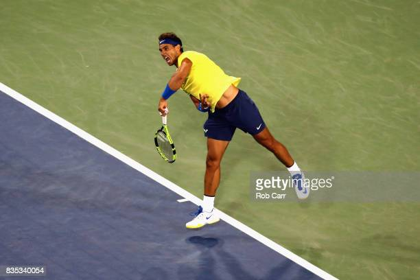 Rafael Nadal of Spain serves to Nick Kyrgios of Australia during Day 7 of the Western and Southern Open at the Linder Family Tennis Center on August...