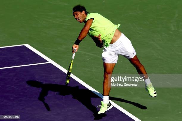 Rafael Nadal of Spain serves to Nicolas Mahut of France during the Miami Open at the Crandon Park Tennis Center on March 28 2017 in Key Biscayne...