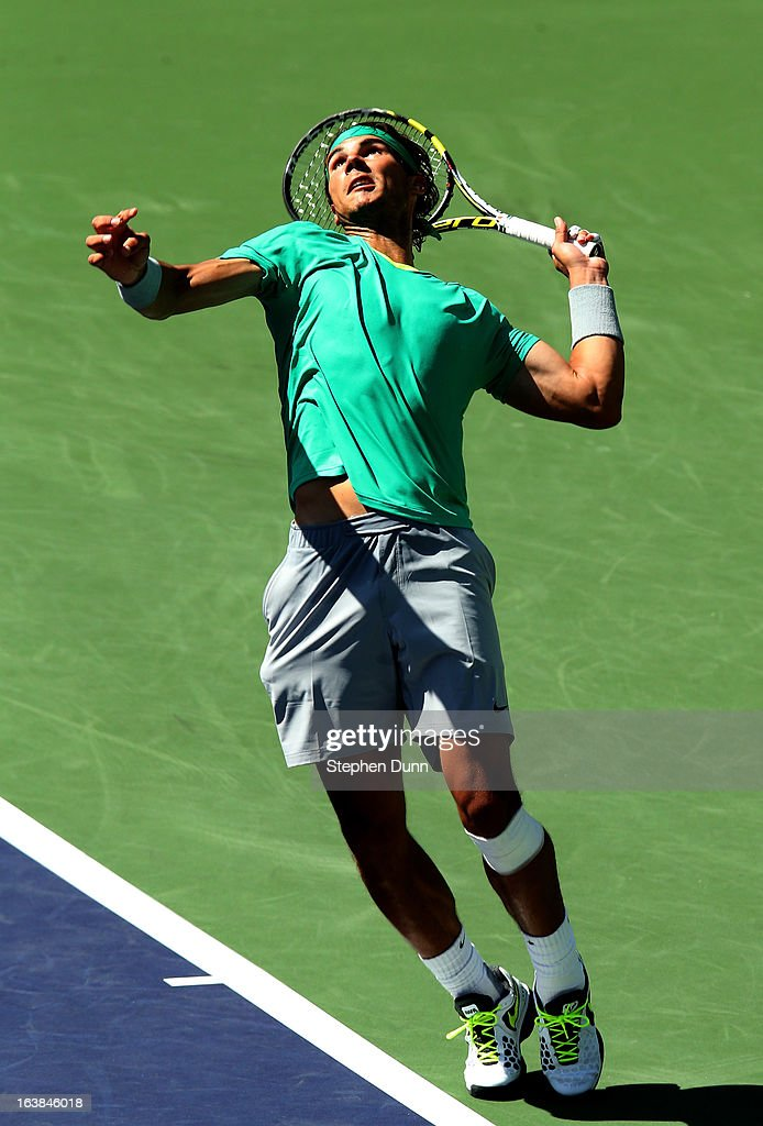 <a gi-track='captionPersonalityLinkClicked' href=/galleries/search?phrase=Rafael+Nadal&family=editorial&specificpeople=194996 ng-click='$event.stopPropagation()'>Rafael Nadal</a> of Spain serves to Tomas Berdych of the Czech Republic in their semifinal match during day 11 of the BNP Paribas Open at Indian Wells Tennis Garden on March 16, 2013 in Indian Wells, California.