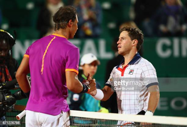 Rafael Nadal of Spain shakes hands at the net after his straight set victory against Diego Schwartzman of Argentina in their quarter final round...