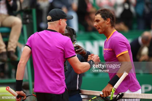 Rafael Nadal of Spain shakes hands at the net after his three set victory against Kyle Edmund of Great Britain in their second round match on day...