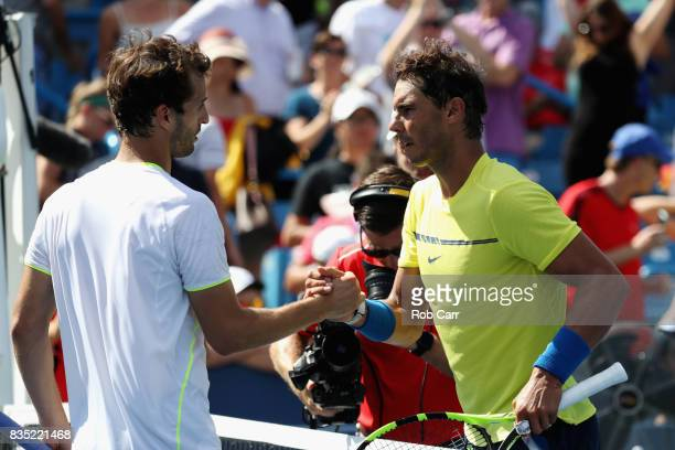 Rafael Nadal of Spain shakes hands with Albert RamosVinolas of Spain after defeating him during Day 7 of the Western and Southern Open at the Linder...