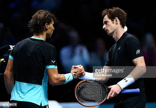 Rafael Nadal of Spain shakes hands with Andy Murray of Great Britain after his victory in their men's singles match during day four of the Barclays...