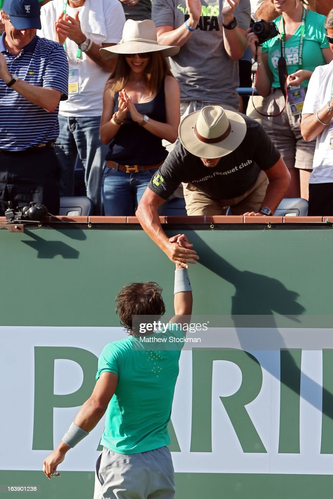 Rafael Nadal of Spain shakes hands with Larry Ellison after he defeated Juan Martin Del Potro of Argentina to win the men's final match of the 2013 BNP Paribas Open at the Indian Wells Tennis Garden on March 17, 2013 in Indian Wells, California.