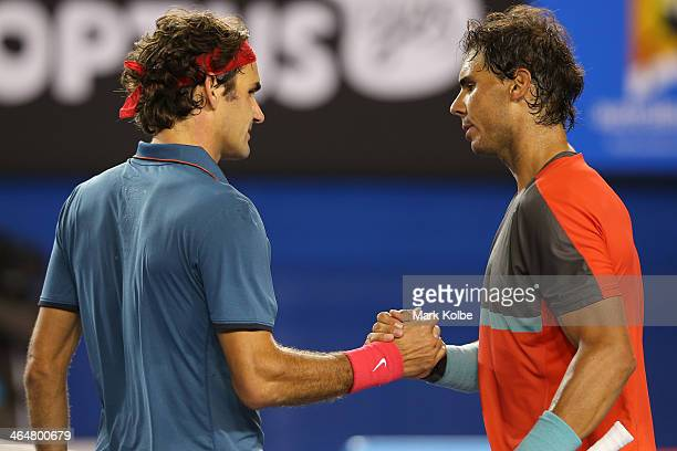 Rafael Nadal of Spain shakes hands with Roger Federer of Switzerland after Nadal won their semifinal match during day 12 of the 2014 Australian Open...