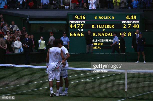 Rafael Nadal of Spain shakes hands with Roger Federer of Switzerland after Nadal won in five sets in the final on day thirteen of the Wimbledon Lawn...