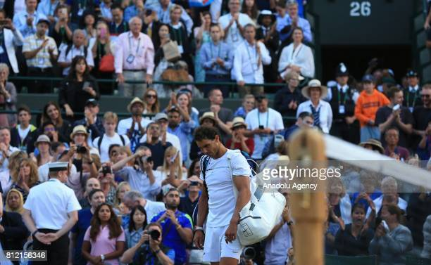 Rafael Nadal of Spain shows dejection after losing to Gilles Muller of Luxembourg on day seven of the 2017 Wimbledon Championships at the All England...